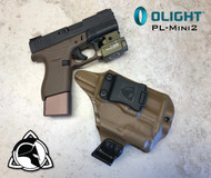 "Weapon Mounted Light Carry System shown.  Does not include Magazine Extension. Rare Earth Magnet Retention Holster for the Glock 43 and the Olight PL-Mini 2.  Shown in Coyote Tan with 1.75"" Black Belt Clip."
