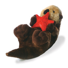 Grasping a beautiful red starfish, this playful brown otter is floating down the stream lying on his back. 12 inches long, he's looking for hugs and new friends.