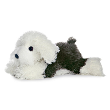 Edwin the dog is stretched out for a full 12 inches of relaxation. Primarily white, Edwin also boasts a saddle of black, floppy ears and a cute tail.