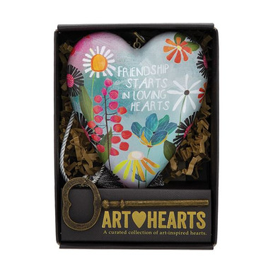 This Art Heart makes a beautiful gift for a dear friend! Art Hearts™ is a curated collection of heart sculptures that offer artistic ways to express love. Hang from the tasseled cord or stand using the decorative key which also functions as a stand. Packaged in a window gift box and ready to gift!  •Measures 4 inches by 3.5 inches •Packaged in a gift-ready window box •Hangs from tasseled cord or stands by inserting the decorative key into back keyhole •Tasseled cord and decorative key included •Message on heart reads Friendship starts in loving hearts