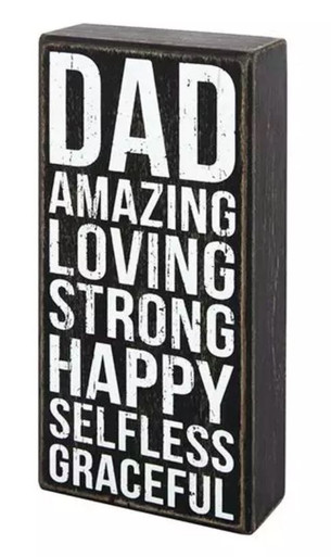 his wooden box sign by Primitives by Kathy® makes a great gift for an amazing dad! Sign has a rustic, vintage look with worn edges, white block lettering, and a faded black background. Message reads Dad Amazing Loving Strong Happy Selfless Graceful. Easy to hang or can free-stand alone.