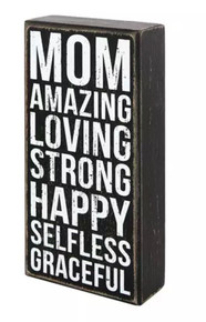 This wooden box sign by Primitives by Kathy® makes a great gift for a loving and selfless mom! Sign has a rustic, vintage look with worn edges, white block lettering, and a faded black background. Message reads Mom Amazing Loving Strong Happy Selfless Graceful. Easy to hang or can free-stand alone.