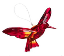 Hummingbird Hanging Ornaments  - each shows a brightly colored hummingbird in flight. Ornaments are made of acrylic with two toned multi color finish, colors may vary.  Approximately 7 x 4 inches; Includes a 3 inch clear filament loop for easy hanging display Perfect for hanging display on an ornament stand or hook.