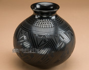 Etched black on black Mata Ortiz pottery vase.