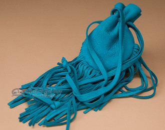 Turquoise Native American fringed bag.