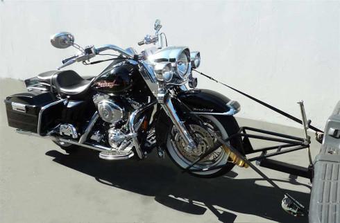 Slick Wheelie hauling motorcycle
