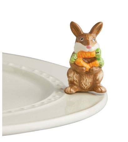 "Nora Fleming's New ""Funny Bunny"" mini shows a bunny with an armload of carrots - and one in his mouth! Adorable for Easter, spring celebrations, and perfect any time of the year for any Nora Fleming serving piece or platter."