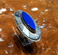 "Kee Nez is the Navajo artist of this incredibly beautiful sterling silver and Lapis cabochon ring. This ring measures 2""H x 1 1/4""W domed. Stone measures 1 1/8""H x 3/8""W. Split shank band, Size 7.  All Mudhead Gallery items as you can see are quality made and all one of a kind. Thanks for looking!"