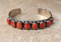 BRACELET NON-NATIVE 8 VERTICAL OVAL ORANGE SPINY OYSTER SHELL CABOCHON BRACELET DON LUCUS