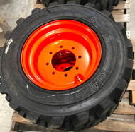 Used Foam Filled Tire Mounted on Orange Rim 10 16.5 Savage Premium Skid Steer 12 Ply DeepTread 10x16.5