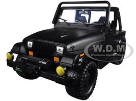 "1992 Jeep Wrangler ""Just Trucks"" with Extra Wheels Matt Black 1/24 Diecast Model Car Jada 98020"