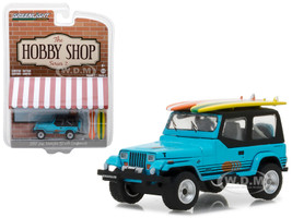 1987 Jeep Wrangler YJ Blue with Surf Board The Hobby Shop Series 2 1/64 Diecast Model Car Greenlight 97020 C