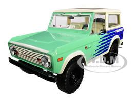 1976 Ford Bronco Green Blue Cream Top Falken Tires 1/18 Diecast Model Car Greenlight 19070