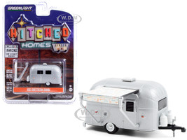 1961 Airstream Bambi Travel Trailer Silver Peace and Love Awning Hitched Homes Series 9 1/64 Diecast Model Greenlight 34090 F