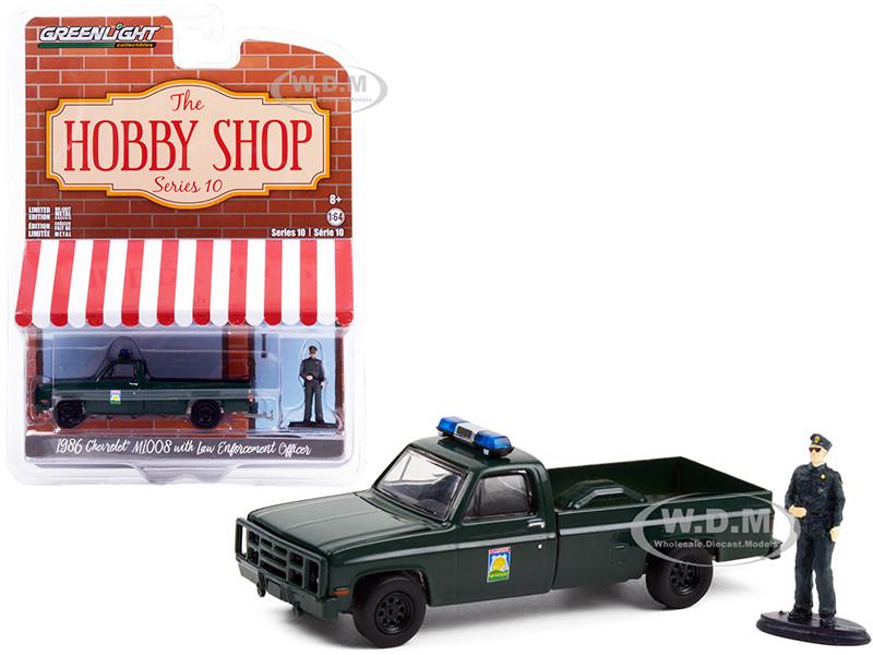1986 Chevrolet M1008 Pickup Truck Dark Green Florida Office Agricultural Law Enforcement Enforcement Officer Figurine The Hobby Shop Series 10 1/64 Diecast Model Car Greenlight 97100 D