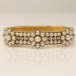 Antique English 15 Karat Gold Diamond and Pearl Bangle Bracelet.