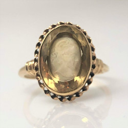 Estate English 10 Karat Gold Citrine Ring with Carving of a Classical Figure.