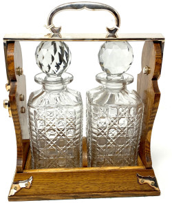 "Antique English Silver-Plated Golden Oak Two Bottle Tantalus, Made by ""Betjemann's & Sons"" of London, Circa 1890."