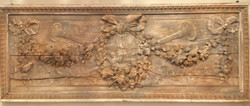 Finely Carved Antique French Louis XVI Style 19th Century Ribbon and Floral Wooden Wall Plaque with Floral Swags, Horns, and Staffs.