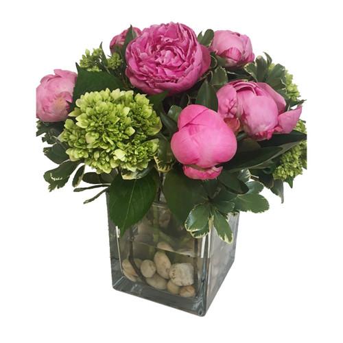 Fresh floral arrangement featuring peonies and mini hydrangeas.