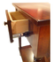 Bedside table with turned legs and secret compartments