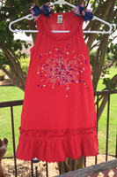 Fourth of July, firecracker dress in size 6 by Kavio. Full of bling, with red white and blue bows on the sleeves, your little firecracker will look adorable in her new dress this July 4th season.