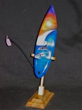 Hawaiian airbrushed surfboard replica on wood stand