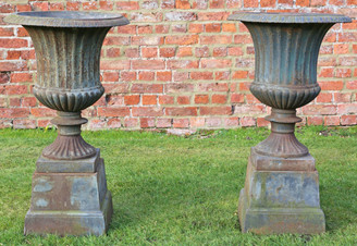 Antique pair of cast iron planters classical urns on plinths