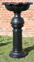 Large antique cast iron planter urn on plinth