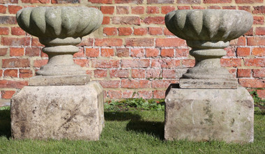 Antique pair of cast stone urns planters plant pots on real stone bases