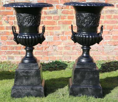 Antique pair of cast iron pots planters urns on plinths