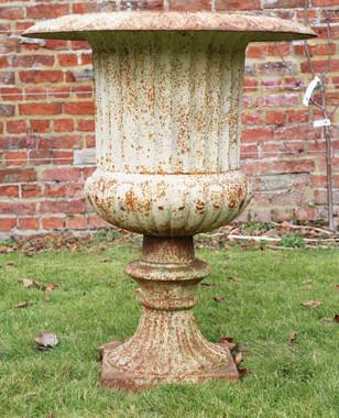 Antique large classical cast iron planter urn on plinth
