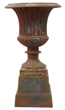 Antique style cast iron planter urn on plinth