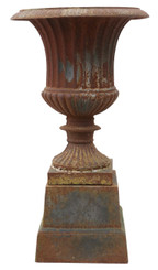 Antique style cast iron planter urn on plinth