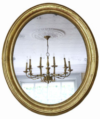 Antique large fine quality oval 19th Century gilt overmantle wall mirror