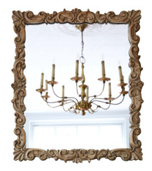Antique quality carved satin walnut overmantle or wall mirror early 20th Century