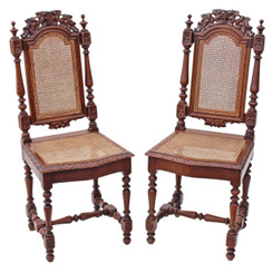 Antique pair of late Victorian gothic carved oak and cane chairs hall side