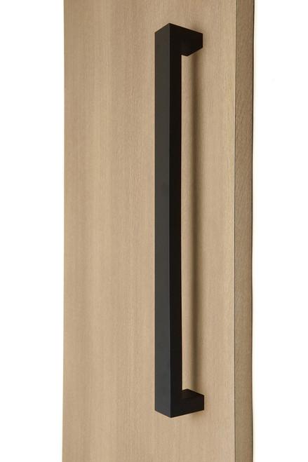 "1.5"" x 1"" Rectangular Pull Handle - Back-to-Back (Matte Black Powder Coated Stainless Steel Finish) mockup on wood door"