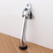 "Stainless Steel Brushed Satin Finish 4"" Door Mounted Heavy-Duty Kick-Down Door Holder mockup on door"