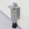 Stainless Steel Brushed Satin Finish Spring Loaded Heavy-Duty Step-On Door Holder mockup on wood door