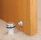 Floor-Mounted Flat Top Magnetic Door Stop with hidden screw mounts (Brass Satin Nickel Finish) mockup on wood door