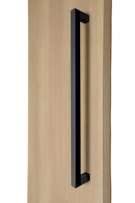 """1"""" x 1"""" Square  Pull Handle - Back-to-Back (Black Powder Stainless Steel Finish) mockup on wood door"""