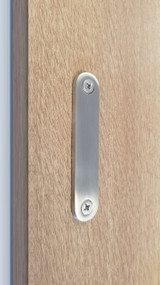 Low-Profile Back-to-Back Sliding  Door Pull  (Brushed Satin Stainless Steel Finish) mockup on wood door