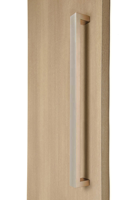 "1.5"" x 1"" Rectangular Pull Handle - Back-to-Back (Brushed Satin Stainless Steel Finish) mockup on wood door"