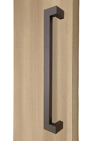 "45º Offset 1.5"" x 1"" Rectangular Pull Handle - Back-to-Back, Bronze Finish, 304 Exterior Grade Stainless Steel Alloy mockup on wood door"
