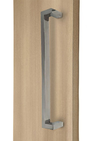 "45º Offset 1"" x 1.5"" Rectangular Pull Handle - Back-to-Back (Polished Stainless Steel Finish) mockup on door"