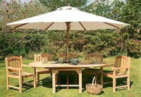 Avon 150cm extending to 210cm oval double leaf table, with 2 Malvern carver and 4 Malvern side chairs comes with a 3m Olive Parasol.