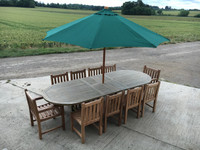 Oval extending 180 x 240cm table with 2 Arm Chairs and 6 Side Chairs  Shown with a 3mtr Parasol