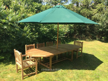 Oval 2.4mtr extending to 3mtr Table with 8 side chairs 2 arm chairs and a 3.3mtr parasol