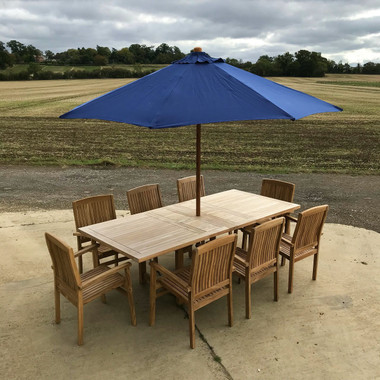 Weathered Arrow Rectangle Table 180cm Extending to 240cm with 8 Henley Stacking Chairs and a 3m Blue parasol
